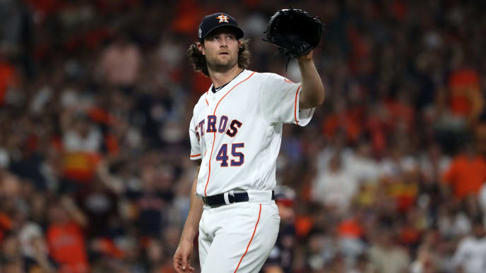 HOUSTON, TEXAS - OCTOBER 22:  Gerrit Cole #45 of the Houston Astros reacts after allowing a run against the Washington Nationals during the fifth inning in Game One of the 2019 World Series at Minute Maid Park on October 22, 2019 in Houston, Texas. (Photo by Elsa/Getty Images)