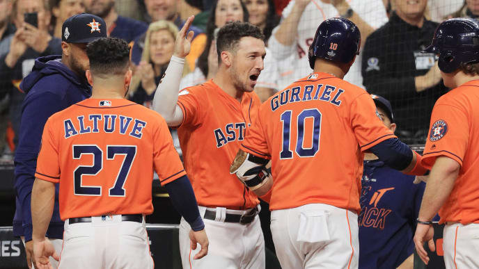 HOUSTON, TEXAS - OCTOBER 30:  Yuli Gurriel #10 of the Houston Astros is congratulated by his teammate Alex Bregman #2 after hitting a solo home run against the Washington Nationals during the second inning in Game Seven of the 2019 World Series at Minute Maid Park on October 30, 2019 in Houston, Texas. (Photo by Mike Ehrmann/Getty Images)