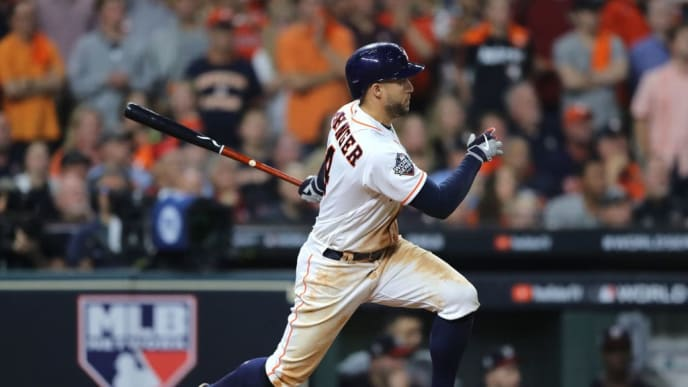 HOUSTON, TEXAS - OCTOBER 29:  George Springer #4 of the Houston Astros hits a double against the Washington Nationals during the fifth inning in Game Six of the 2019 World Series at Minute Maid Park on October 29, 2019 in Houston, Texas. (Photo by Elsa/Getty Images)