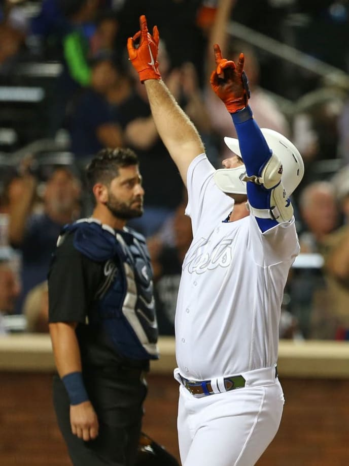 NEW YORK, NY - AUGUST 24: Pete Alonso #20 of the New York Mets reacts after hitting a three-run home run against the Atlanta Braves during the fifth inning of a game at Citi Field on August 24, 2019 in New York City. Teams are wearing special color schemed uniforms with players choosing nicknames to display for Players' Weekend. (Photo by Rich Schultz/Getty Images)