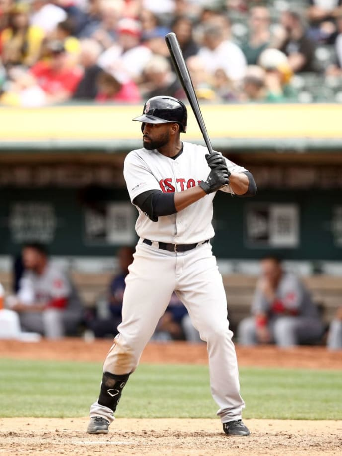 OAKLAND, CALIFORNIA - APRIL 04:  Jackie Bradley Jr. #19 of the Boston Red Sox bats against the Oakland Athletics at Oakland-Alameda County Coliseum on April 04, 2019 in Oakland, California. (Photo by Ezra Shaw/Getty Images)