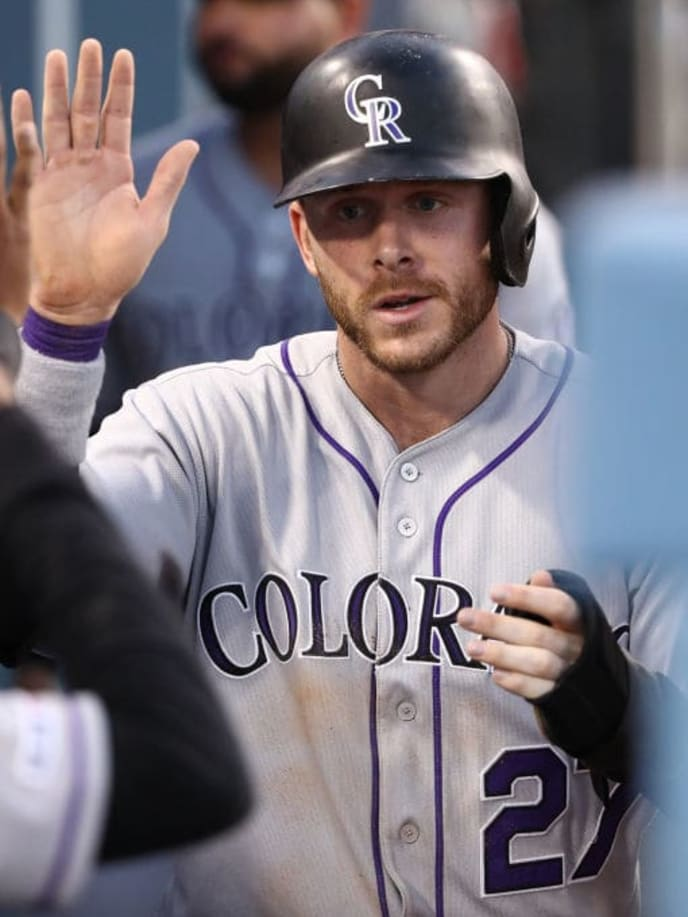 LOS ANGELES, CALIFORNIA - SEPTEMBER 02: Trevor Story #27 of the Colorado Rockies celebrates with teammates in the dugout after scoring in the fifth inning of the MLB game against the Los Angeles Dodgers at Dodger Stadium on September 02, 2019 in Los Angeles, California. The Dodgers defeated the Rockies 16-9. (Photo by Victor Decolongon/Getty Images)