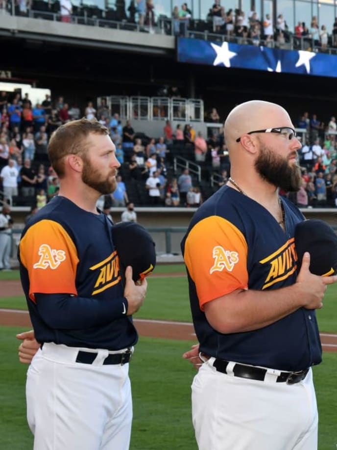 LAS VEGAS, NEVADA - JULY 13:  (L-R) Pitcher Ben Bracewell #43 and catcher Cameron Rupp #37 of the Las Vegas Aviators and chef Giada De Laurentiis stand on the field as the American national anthem is performed before the Aviators' game against the Salt Lake Bees during De Laurentiis' celebrity chef appearance at Las Vegas Ballpark on July 13, 2019 in Las Vegas, Nevada.  (Photo by Ethan Miller/Getty Images for Las Vegas Ballpark)