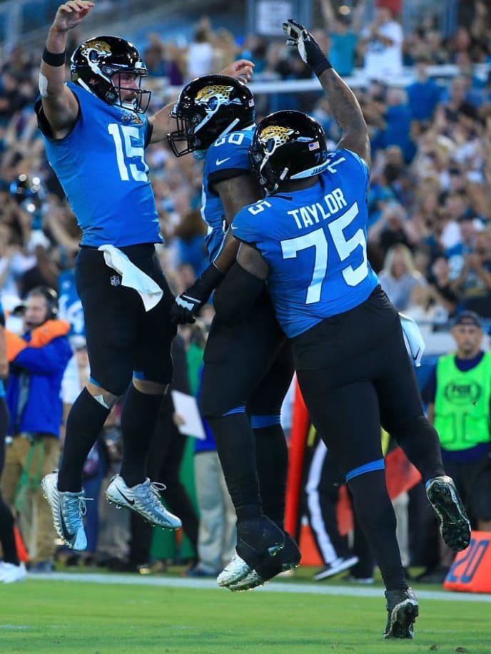 JACKSONVILLE, FLORIDA - SEPTEMBER 19: Quarterback Gardner Minshew #15 of the Jacksonville Jaguars celebrates a touchdown in the first quarter over the Tennessee Titans during the game at TIAA Bank Field on September 19, 2019 in Jacksonville, Florida. (Photo by Mike Ehrmann/Getty Images)