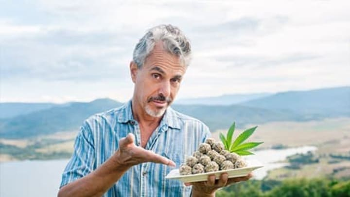 Chris poses with a plate of cannabis majoon balls.