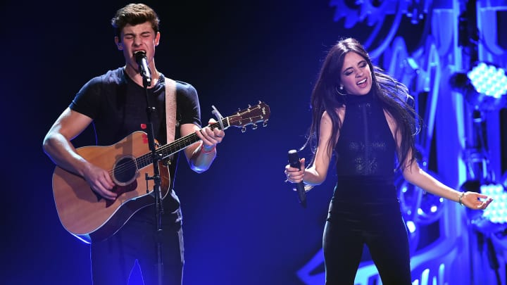 LOS ANGELES, CA - DECEMBER 04:  Recording artists Shawn Mendes (L) and Camila Cabello of Fifth Harmony perform onstage during 102.7 KIIS FM's Jingle Ball 2015 Presented by Capital One at STAPLES CENTER on December 4, 2015 in Los Angeles, California.  (Photo by Kevin Winter/Getty Images for iHeartMedia)