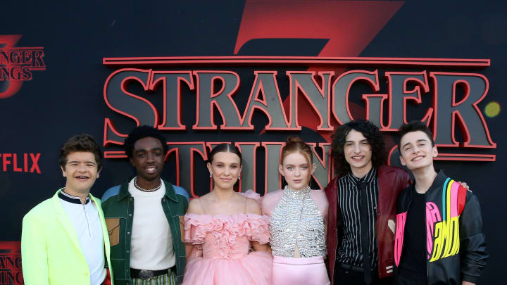 "SANTA MONICA, CALIFORNIA - JUNE 28: (L-R) Gaten Matarazzo, Caleb McLaughlin, Millie Bobby Brown, Sadie Sink, Finn Wolfhard, and Noah Schnapp attend the ""Stranger Things"" Season 3 World Premiere on June 28, 2019 in Santa Monica, California. (Photo by Rachel Murray/Getty Images for Netflix)"