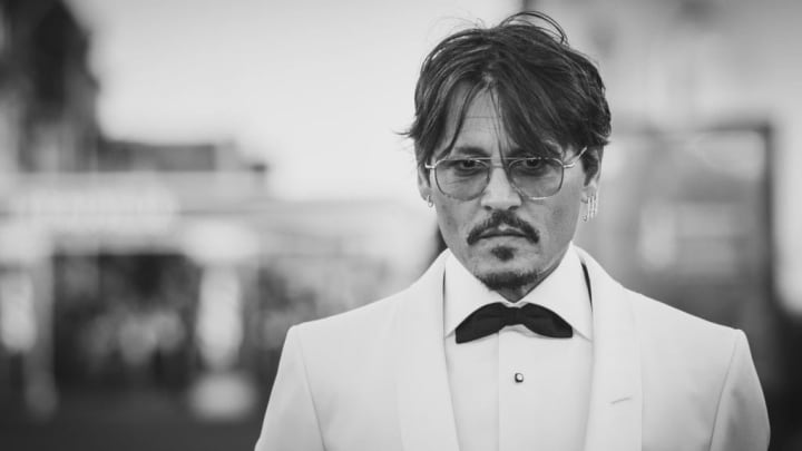DEAUVILLE, FRANCE - SEPTEMBER 08:  (EDITORS NOTE: image was processed with digital filters and has been converted to B&W) Johnny Depp receives a tribute during the 45th Deauville American Film Festival on September 08, 2019 in Deauville, France. (Photo by Francois G. Durand/Getty Images)