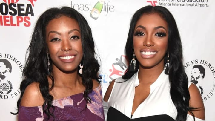 ATLANTA, GA - FEBRUARY 25:  TV personality Porsha Williams (R) with her sister Lauren Williams (L) attend 2018 Hosea's Heroes Awards at Loudermilk Conference Center on February 25, 2018 in Atlanta, Georgia.  (Photo by Paras Griffin/Getty Images)