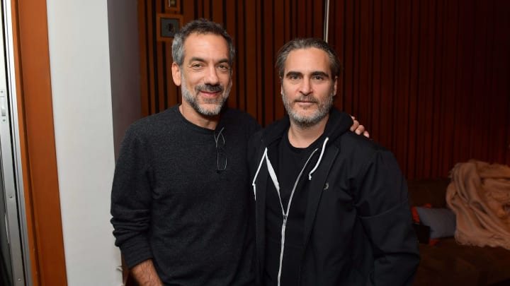 "HOLLYWOOD, CALIFORNIA - OCTOBER 28: (L-R) Todd Phillips and Joaquin Phoenix attend the release party to celebrate Rain Phoenix's new album ""RIVER"", hosted by Joaquin Phoenix at Jim Henson Studios on October 28, 2019 in Hollywood, California. (Photo by Matt Winkelmeyer/Getty Images)"