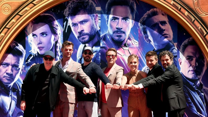 """HOLLYWOOD, CA - APRIL 23: (EDITORS NOTE: Retransmission with alternate crop.) Marvel Studios' """"Avengers: Endgame"""" stars President of Marvel Studios/Producer Kevin Feige, Chris Hemsworth, Chris Evans, Robert Downey Jr., Scarlett Johansson, Jeremy Renner and Mark Ruffalo at the Hand And Footprint Ceremony at the TCL Chinese Theatre on April 23, 2019 in Hollywood, California.  (Photo by Alberto E. Rodriguez/Getty Images for Disney)"""