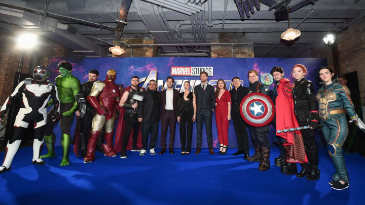 """LONDON, ENGLAND - APRIL 10:  (centre L-R) Joe Russo, Paul Rudd, Scarlett Johansson, Chris Hemsworth, Trinh Tran and Anthony Russo pose with Marvel characters as they attend the UK Fan Event to celebrate the release of Marvel Studios' """"Avengers: Endgame"""" at Picturehouse Central on April 10, 2019 in London, England. (Photo by Eamonn M. McCormack/Getty Images for Disney)"""