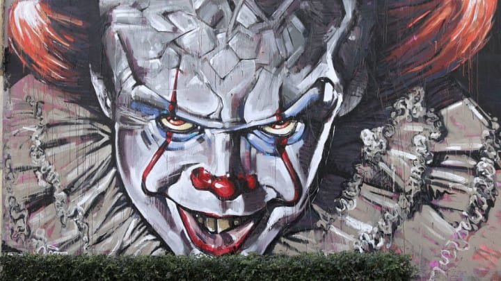 "SYDNEY, AUSTRALIA - AUGUST 28:  A wall mural of Pennywise the clown from the movie ""IT"" painted by Scott Marsh is seen on Cleveland street wall in the suburb of Chippendale on August 28, 2017 in Sydney, Australia. The movie ""IT"" based on the 1986 horror novel by American author Stephen King is set for release in cinemas on September 7th. (Photo by Mark Kolbe/Getty Images)"