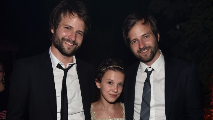 """LOS ANGELES, CA - JULY 11:  Creator/executive producer Ross Duffer, actress Millie Brown and creator/executive producer Matt Duffer attend the after party for the premiere of Netflix's """"Stranger Things"""" at Mack Sennett Studios on July 11, 2016 in Los Angeles, California.  (Photo by Alberto E. Rodriguez/Getty Images)"""
