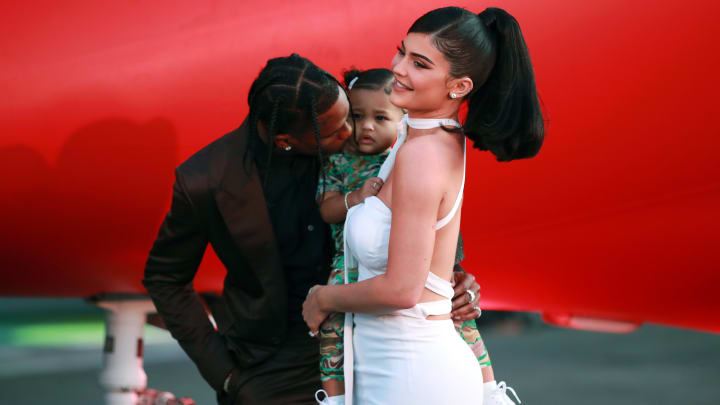 """SANTA MONICA, CALIFORNIA - AUGUST 27: (L-R) Travis Scott, Stormi Webster, and Kylie Jenner attend the premiere of Netflix's """"Travis Scott: Look Mom I Can Fly"""" at Barker Hangar on August 27, 2019 in Santa Monica, California. (Photo by Rich Fury/Getty Images)"""