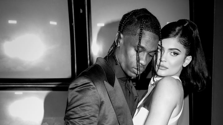 """SANTA MONICA, CALIFORNIA - AUGUST 27: (EDITORS NOTE: Image has been converted to black and white.)  Travis Scott and Kylie Jenner attend the premiere of Netflix's """"Travis Scott: Look Mom I Can Fly"""" at Barker Hangar  on August 27, 2019 in Santa Monica, California. (Photo by Rich Fury/Getty Images)"""