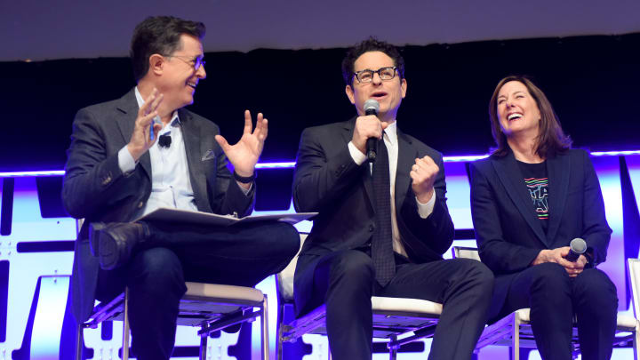 """CHICAGO, IL - APRIL 12: (L-R) Moderator Stephen Colbert, Director J.J. Abrams and Producer Kathleen Kennedy onstage during """"The Rise of Skywalker"""" panel at the Star Wars Celebration at McCormick Place Convention Center on April 12, 2019 in Chicago, Illinois.  (Photo by Daniel Boczarski/Getty Images for Disney )"""
