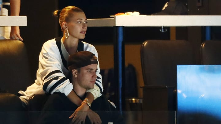 BOSTON, MASSACHUSETTS - APRIL 23: Justin Bieber and wife Hailey Rhode Bieber watch Game Seven of the Eastern Conference First Round during the 2019 NHL Stanley Cup Playoffs between the Boston Bruins and the Toronto Maple Leafs at TD Garden on April 23, 2019 in Boston, Massachusetts. (Photo by Omar Rawlings/Getty Images)