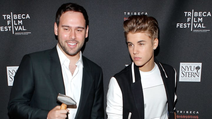 NEW YORK, NY - APRIL 27:  Scooter Braun and Singer Justin Bieber attend the Tribeca Disruptive Innovation Awards during the 2012 Tribeca Film Festival at the NYU Paulson Auditorium on April 27, 2012 in New York City.  (Photo by Jemal Countess/Getty Images)