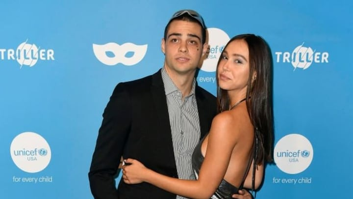 WEST HOLLYWOOD, CALIFORNIA - OCTOBER 26: Noah Centineo and Alexis Ren attend the UNICEF Masquerade Ball at Kimpton La Peer Hotel on October 26, 2019 in West Hollywood, California. (Photo by Frazer Harrison/Getty Images)