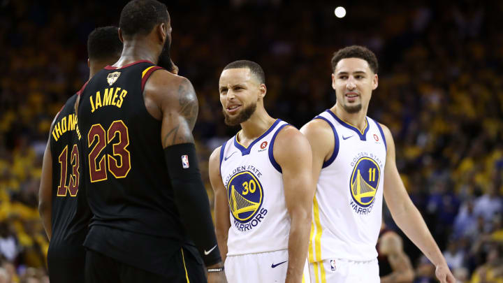 OAKLAND, CA - MAY 31:  Stephen Curry #30 and Klay Thompson #11 of the Golden State Warriors exchange words with LeBron James #23 of the Cleveland Cavaliers in overtime during Game 1 of the 2018 NBA Finals at ORACLE Arena on May 31, 2018 in Oakland, California. NOTE TO USER: User expressly acknowledges and agrees that, by downloading and or using this photograph, User is consenting to the terms and conditions of the Getty Images License Agreement.  (Photo by Ezra Shaw/Getty Images)