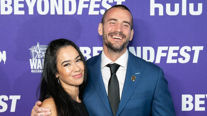 "HOLLYWOOD, CALIFORNIA - OCTOBER 01: AJ Mendez and Phil ""CM Punk"" Brooks attend the Beyond Fest Premiere Of ""Girl On The Third Floor""at the Egyptian Theatre on October 01, 2019 in Hollywood, California. (Photo by John Wolfsohn/Getty Images)"