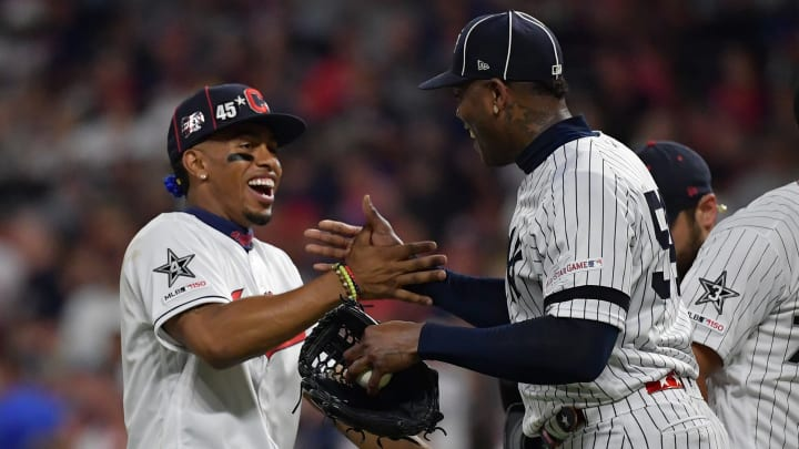 CLEVELAND, OHIO - JULY 09: Francisco Lindor #12 of the Cleveland Indians and Aroldis Chapman #54 of the New York Yankees during the 2019 MLB All-Star Game at Progressive Field on July 09, 2019 in Cleveland, Ohio. (Photo by Jason Miller/Getty Images)