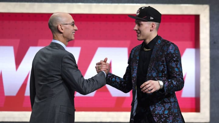 Tyler Herro with a fan at the NBA Draft.
