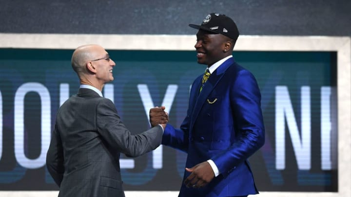 NEW YORK, NEW YORK - JUNE 20: Mfiondu Kabengele poses with NBA Commissioner Adam Silver after being drafted with the 27th overall pick by the Brooklyn Nets during the 2019 NBA Draft at the Barclays Center on June 20, 2019 in the Brooklyn borough of New York City. NOTE TO USER: User expressly acknowledges and agrees that, by downloading and or using this photograph, User is consenting to the terms and conditions of the Getty Images License Agreement. (Photo by Sarah Stier/Getty Images)