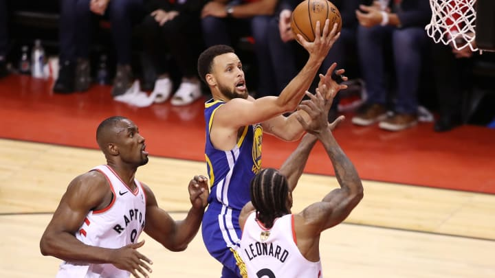 TORONTO, ONTARIO - JUNE 10:  Stephen Curry #30 of the Golden State Warriors attempts a shot against Serge Ibaka #9 and Kawhi Leonard #2 of the Toronto Raptors in the second half during Game Five of the 2019 NBA Finals at Scotiabank Arena on June 10, 2019 in Toronto, Canada. NOTE TO USER: User expressly acknowledges and agrees that, by downloading and or using this photograph, User is consenting to the terms and conditions of the Getty Images License Agreement. (Photo by Claus Andersen/Getty Images)