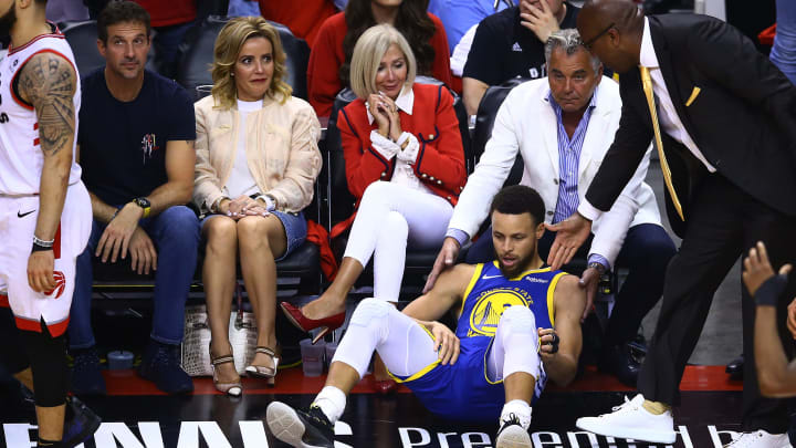 TORONTO, ONTARIO - JUNE 10:  Stephen Curry #30 of the Golden State Warriors gets tripped up against the Toronto Raptors in the first half during Game Five of the 2019 NBA Finals at Scotiabank Arena on June 10, 2019 in Toronto, Canada. NOTE TO USER: User expressly acknowledges and agrees that, by downloading and or using this photograph, User is consenting to the terms and conditions of the Getty Images License Agreement. (Photo by Vaughn Ridley/Getty Images)