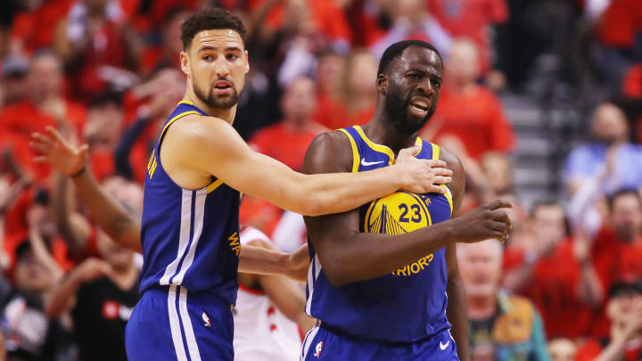 TORONTO, ONTARIO - JUNE 10:  Klay Thompson #11 and Draymond Green #23 of the Golden State Warriors react after a foul call against the Toronto Raptors in the first half during Game Five of the 2019 NBA Finals at Scotiabank Arena on June 10, 2019 in Toronto, Canada. NOTE TO USER: User expressly acknowledges and agrees that, by downloading and or using this photograph, User is consenting to the terms and conditions of the Getty Images License Agreement. (Photo by Gregory Shamus/Getty Images)