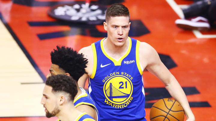 TORONTO, ONTARIO - MAY 30:  Jonas Jerebko #21 of the Golden State Warriors celebrates the play against the Toronto Raptors in the second quarter during Game One of the 2019 NBA Finals at Scotiabank Arena on May 30, 2019 in Toronto, Canada. NOTE TO USER: User expressly acknowledges and agrees that, by downloading and or using this photograph, User is consenting to the terms and conditions of the Getty Images License Agreement. (Photo by Vaughn Ridley/Getty Images)