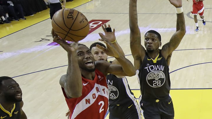OAKLAND, CALIFORNIA - JUNE 13:  Kawhi Leonard #2 of the Toronto Raptors attempts a shot against the Golden State Warriors during Game Six of the 2019 NBA Finals at ORACLE Arena on June 13, 2019 in Oakland, California. NOTE TO USER: User expressly acknowledges and agrees that, by downloading and or using this photograph, User is consenting to the terms and conditions of the Getty Images License Agreement. (Photo by Tony Avelar-Pool/Getty Images)
