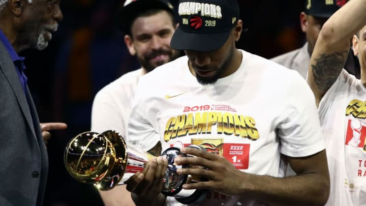 OAKLAND, CALIFORNIA - JUNE 13:  Kawhi Leonard #2 of the Toronto Raptors is awarded the MVP after his team defeated the Golden State Warriors to win Game Six of the 2019 NBA Finals at ORACLE Arena on June 13, 2019 in Oakland, California. NOTE TO USER: User expressly acknowledges and agrees that, by downloading and or using this photograph, User is consenting to the terms and conditions of the Getty Images License Agreement. (Photo by Ezra Shaw/Getty Images)