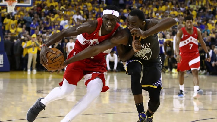 OAKLAND, CALIFORNIA - JUNE 13:  Pascal Siakam #43 of the Toronto Raptors is defended by Draymond Green #23 of the Golden State Warriors in the second half during Game Six of the 2019 NBA Finals at ORACLE Arena on June 13, 2019 in Oakland, California. NOTE TO USER: User expressly acknowledges and agrees that, by downloading and or using this photograph, User is consenting to the terms and conditions of the Getty Images License Agreement. (Photo by Ezra Shaw/Getty Images)
