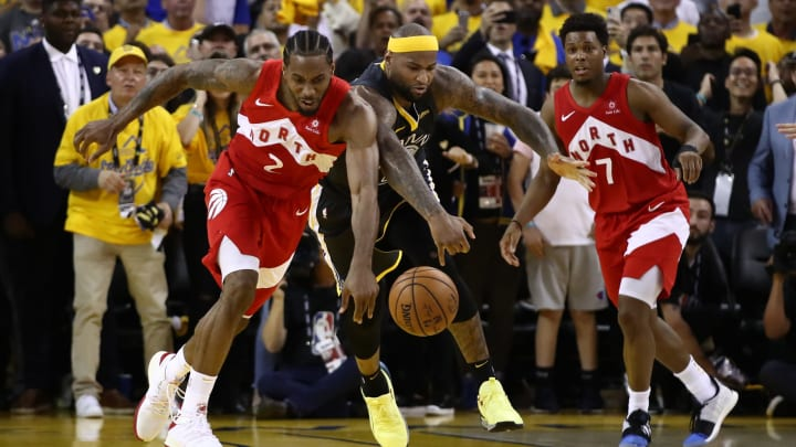 OAKLAND, CALIFORNIA - JUNE 13:  Kawhi Leonard #2 of the Toronto Raptors and DeMarcus Cousins #0 of the Golden State Warriors battle for the ball late in the game during Game Six of the 2019 NBA Finals at ORACLE Arena on June 13, 2019 in Oakland, California. NOTE TO USER: User expressly acknowledges and agrees that, by downloading and or using this photograph, User is consenting to the terms and conditions of the Getty Images License Agreement. (Photo by Ezra Shaw/Getty Images)