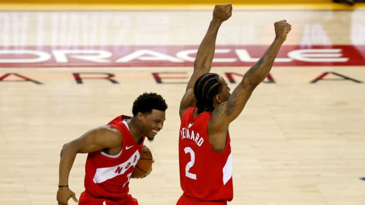 OAKLAND, CALIFORNIA - JUNE 13:  Kyle Lowry #7 and Kawhi Leonard #2 of the Toronto Raptors celebrates his teams win over the Golden State Warriors in Game Six to win the 2019 NBA Finals at ORACLE Arena on June 13, 2019 in Oakland, California. NOTE TO USER: User expressly acknowledges and agrees that, by downloading and or using this photograph, User is consenting to the terms and conditions of the Getty Images License Agreement. (Photo by Lachlan Cunningham/Getty Images)