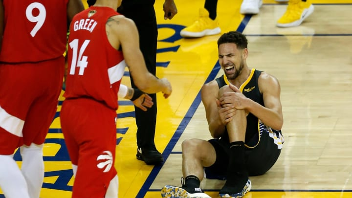 OAKLAND, CALIFORNIA - JUNE 13:  Klay Thompson #11 of the Golden State Warriors reacts after hurting his leg against the Toronto Raptors in the second half during Game Six of the 2019 NBA Finals at ORACLE Arena on June 13, 2019 in Oakland, California. NOTE TO USER: User expressly acknowledges and agrees that, by downloading and or using this photograph, User is consenting to the terms and conditions of the Getty Images License Agreement. (Photo by Lachlan Cunningham/Getty Images)