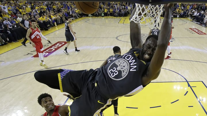 OAKLAND, CALIFORNIA - JUNE 13:  Draymond Green #23 of the Golden State Warriors dunks the ball against the Toronto Raptors during Game Six of the 2019 NBA Finals at ORACLE Arena on June 13, 2019 in Oakland, California. NOTE TO USER: User expressly acknowledges and agrees that, by downloading and or using this photograph, User is consenting to the terms and conditions of the Getty Images License Agreement. (Photo by Tony Avelar-Pool/Getty Images)