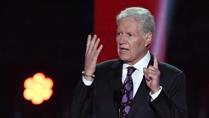 """LAS VEGAS, NEVADA - JUNE 19:  """"Jeopardy!"""" host Alex Trebek presents the Hart Memorial Trophy during the 2019 NHL Awards at the Mandalay Bay Events Center on June 19, 2019 in Las Vegas, Nevada.  (Photo by Ethan Miller/Getty Images)"""