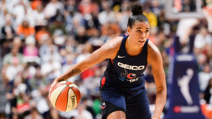 UNCASVILLE, CT - OCTOBER 6: Natasha Cloud #9 of the Washington Mystics dribbles the ball against the Connecticut Sun in the second quarter of Game 3 of the WNBA Finals at Mohegan Sun Arena on October 6, 2019 in Uncasville, Connecticut. NOTE TO USER: User expressly acknowledges and agrees that, by downloading and or using this photograph, User is consenting to the terms and conditions of the Getty Images License Agreement. (Photo by Kathryn Riley/Getty Images)
