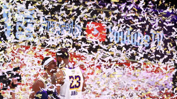 LeBron James and Rajon Rondo celebrate in Orlando.