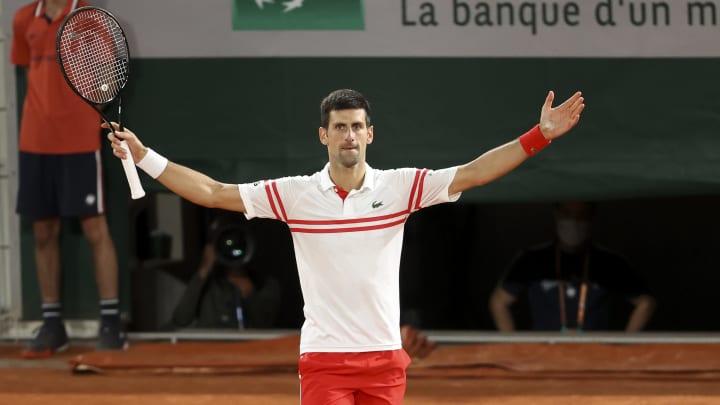 Novak Djokovic celebrating his French Open semifinal win.