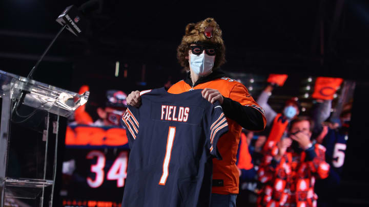 A Chicago Bears fan holding the first Justin Fields jersey.