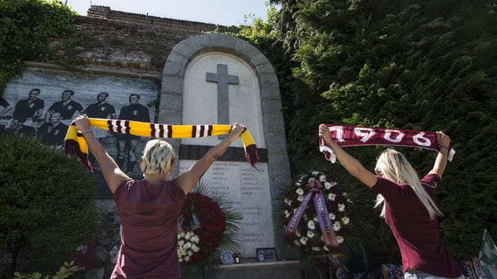 Torino fans pay their respects at the site of the Superga Air Disaster