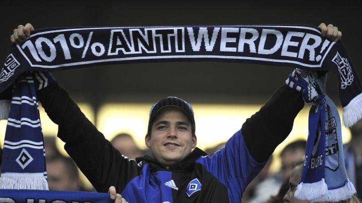 A Hamburg fan displays his scarf prior t