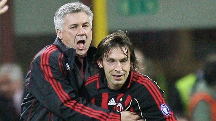AC Milan's trainer Carlo Ancelotti (L) j...