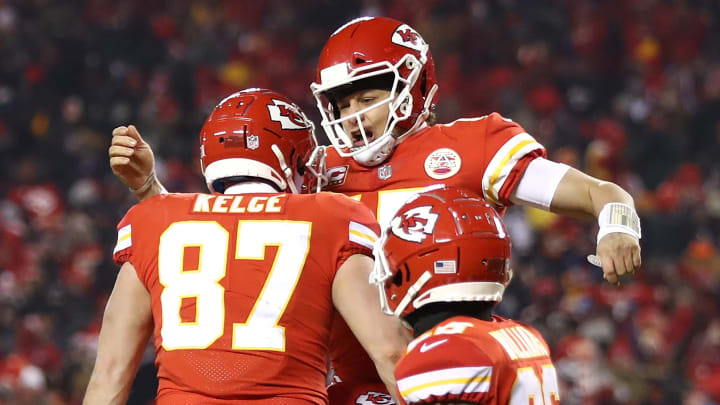 KANSAS CITY, MISSOURI - JANUARY 20: Patrick Mahomes #15 of the Kansas City Chiefs celebrates with Travis Kelce #87 after scoring a touchdown in the third quarter against the New England Patriots during the AFC Championship Game at Arrowhead Stadium on January 20, 2019 in Kansas City, Missouri. (Photo by Jamie Squire/Getty Images)
