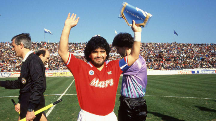 Maradona in the iconic red away kit
